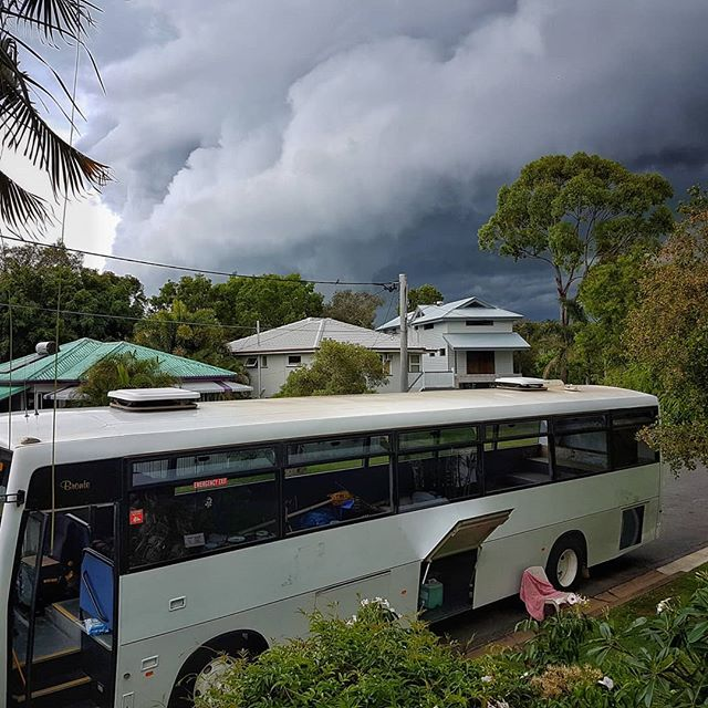 The joys of converting a bus during a tropical Queensland summer! One minute it was blue skies and I was happily painting window frames (we removed two large fixed windows this week) and the next minute... a midday storm and torrential downpour! I don't mind. The recent heavy rains have been super helpful in showing me where the roof and window leaks are located!  #busconversion #buslife #bus #tinyhouse #skoolie #skoolieconversion #vanlife #offgrid #busbuild #rvlife #busnut #busrollwithit #livesmaller #nomad #happycamper #wander #wanderlust #homeiswhereyouparkit #ontheroad