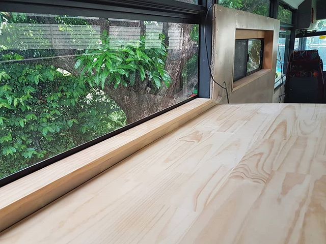 The first of our kitchen benchtops is now in position. The kitchen area is a long way from finished, but it's off to a promising start. We love the ample natural light and window views from our new kitchen already! ~ Keiran.  #busconversion #buslife #bus #tinyhouse #skoolie #skoolieconversion #vanlife #offgrid #busbuild #rvlife #busnut #busrollwithit #livesmaller #nomad #happycamper #wander #wanderlust #homeiswhereyouparkit #ontheroad #buslifeaustralia #buslifeau