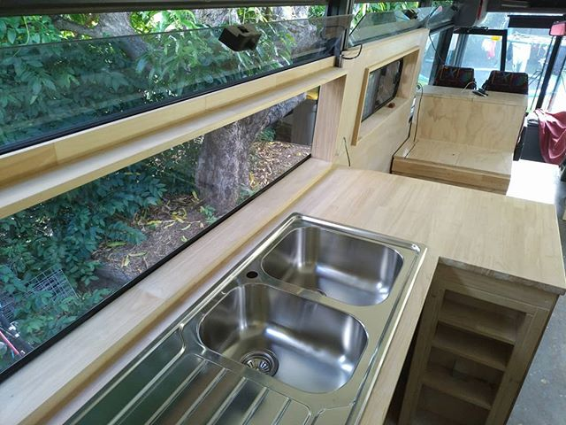Just a little bit excited to see the kitchen sink go in today! I almost look forward to washing the dishes with an ever-changing window view each day! ~ Keiran.  #busconversion #bus #buslife #busliving #rvlife #rvliving #skoolieconversion #tinyhouse #motorhome